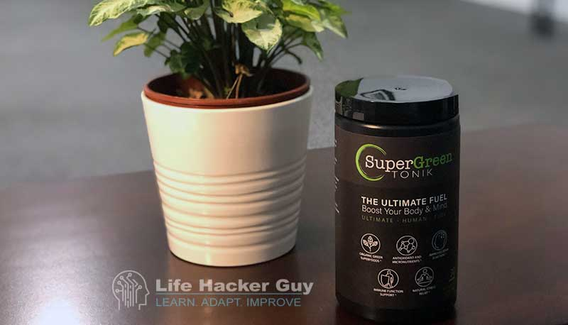 Green superfood on wooden table