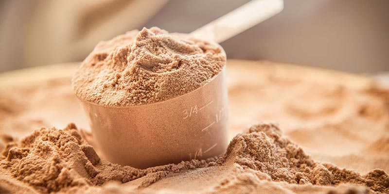 Chocolate Powder supplement and scoop